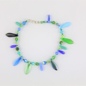Bracelet Fleurs de lotus Hanaya Bijoux, perles de cristal de Bohême, Polaris et SWAROVSKI® ELEMENTS. Attache mousqueton en argent 925.